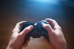Free Video Game Controller In Human Hands, In Front Of The TV Royalty Free Stock Photo - 135923945