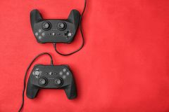 Video game controllers. On color background Stock Photos