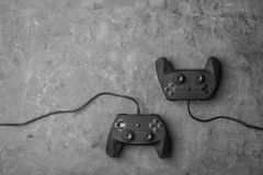 Video game controllers. On grey background Royalty Free Stock Photos