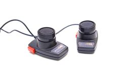 Video game controllers from 1980s. Video game driving controllers for Atari console from the 1980s Stock Photo