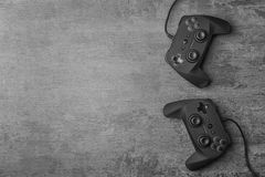 Video game controllers. On grey background Stock Photos