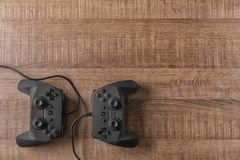 Video game controllers. On wooden background Stock Photo