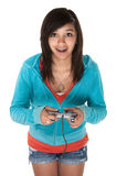 Video Game Girl. Cute young Hispanic teen using a video game controller Stock Image