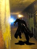 Video game man running. A video game a criminal escaping through a tunnel Stock Photography