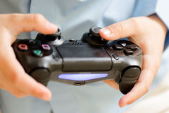 Video game remoter. In young boy hands Royalty Free Stock Photos