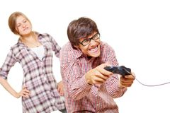 Video game teen and his angry girl Stock Image