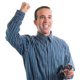 Video Game Winner. An adult winning at his video game that he was playing, isolated against a white background Stock Photography