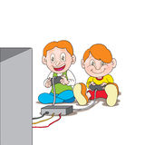 Video gamers. Two young cute happy boys playing a video game sitting,  smilling together Stock Photo