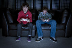 Video Games. Two boys sitting on a couch playing video games Royalty Free Stock Photo