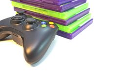 Video Games. Video game controller and games  on white Royalty Free Stock Photos