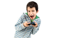 Video games. Boy playing video games making faces isolated in white Stock Photo