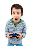 Video games. Boy playing video games making faces isolated in white Stock Photography