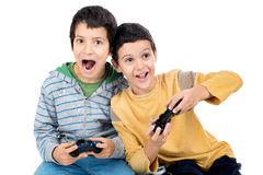 Video games. Boys playing video games isolated in white Stock Photography