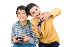 Video games. Boys playing video games isolated in white Royalty Free Stock Images