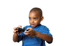 Video games fun 2. A young child having fun playing video games Royalty Free Stock Photography