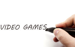 Video Games hand Written. Video Games being hand written with a black marker making a great concept Royalty Free Stock Photography