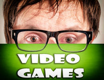 Video games. Man holding video games over his face Stock Photos