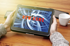 Video games. Playing video games on the tablet Stock Image