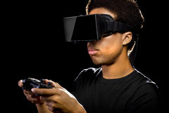Video Games with VR Headset and Controller. Virtual Reality headset on a black male with video game controller Stock Photography