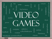 Video Games Word Cloud Concept on a Blackboard. With great terms such as addictive, violent, children, play, rating, fun and more Royalty Free Stock Photography