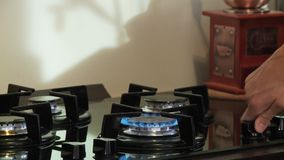 Gas stove turn on flame blue. Video of gas stove turn on flame blue stock video
