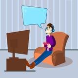 Video gioco telecomandato TV Sit In Armchair del computer del gioco delle cuffie di usura della console della tenuta dell'uomo Immagine Stock