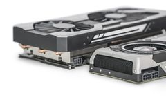 Two Video Graphics cards with powerful GPU isolated on white. Video Graphics card with powerful and modern GPU isolated on white background Stock Images