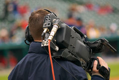Video Guy. A professional videographer at a baseball game Stock Images