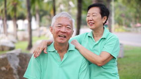 Video Happy Asian senior couple smiling after exercise in the park stock video footage