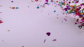 Heart confetti blows away. Video of heart confetti blows away stock footage