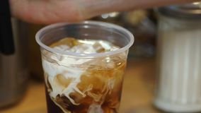 Video of ice coffee served with cream stock video footage