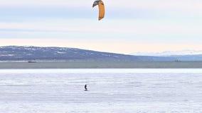 Ice kite skiing stock video