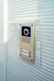 Video intercom device on building exterior wall Stock Photos