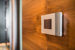Video intercom display on wooden wall Royalty Free Stock Images
