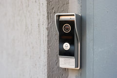 Video intercom in the entry of a house. Close up modern video intercom in the entry of a house Royalty Free Stock Photography