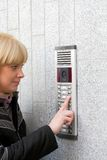 Video intercom and young blonde woman Stock Photography