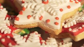 Video 4k, decorating cookies of ginger cake for Christmas. multi-colored cookies. Multi-colored a liver for Christmas. Beautiful cookies. Festive cookies. The stock video footage