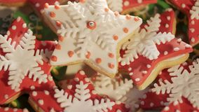 Video 4k, decorating cookies of ginger cake for Christmas. multi-colored cookies. Multi-colored a liver for Christmas. Beautiful cookies. Festive cookies. The stock video