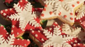 Video 4k, decorating cookies of ginger cake for Christmas. multi-colored cookies. Multi-colored a liver for Christmas. Beautiful cookies. Festive cookies. The stock footage