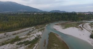 Flight over mountain river. Video 4k flight over the mountain river water, travel around Italy. flight over mountain river. the nature of Italy from a bird`s eye stock video footage