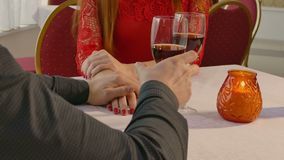 Video 4K man and girl woman evening in restaurant drinking romantic wine, Valentine's Day stock video