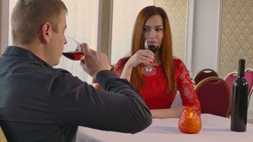 Video 4K man and girl woman evening romantic in restaurant drinking wine, Valentine's Day. Video 4K  man and girl woman evening romantic in restaurant drinking stock video footage