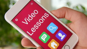 Video lessons concept application on the smartphone. Man uses mobile app. Stock footage stock video