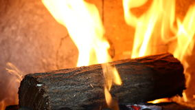Video of a log in fireplace Stock Images