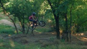 Long jump on springboard of biker stock video footage