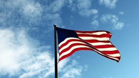 Fixed Shot of American Flag Flapping in the Wind with a Blue Sky as Background
