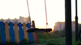 A Lonely swing. Video making - a lonely swing set stock video footage