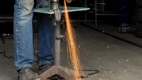 3 in 1 video. Male worker with angular grinding machine is cutting the metal stock footage
