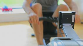 Video of a man rowing in a machine Royalty Free Stock Photo