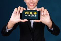 Video marketing concept, Happy businesswoman Show text video mar stock image